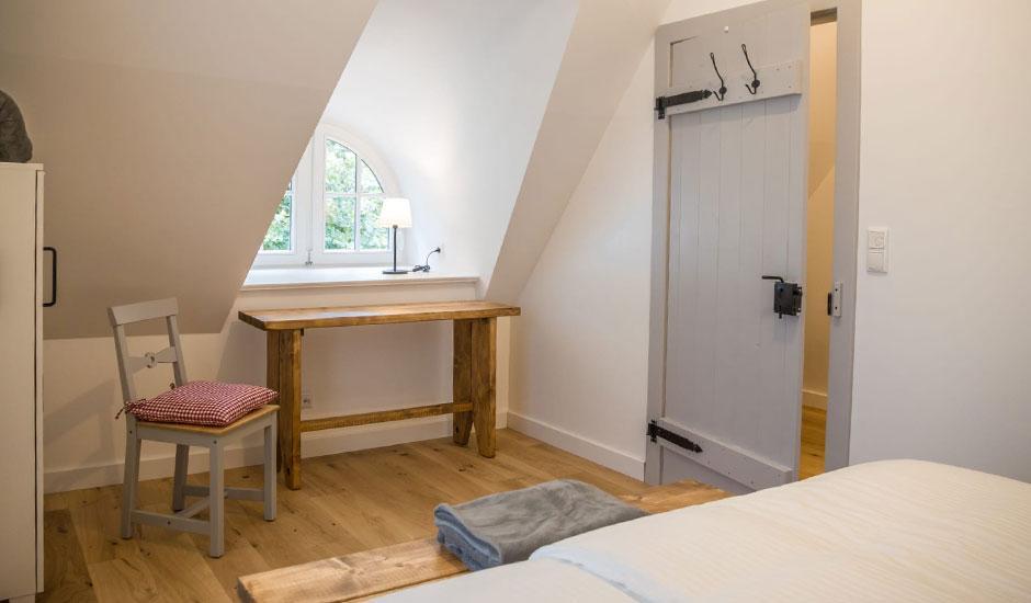 Schlafzimmer im Hoheneichen Hohwacht Reetdach Ferienhaus an der Ostsee